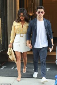 Priyanka Chopra spotted taking a stroll with Nick Jonas in London with her hand in his pocket. See pics